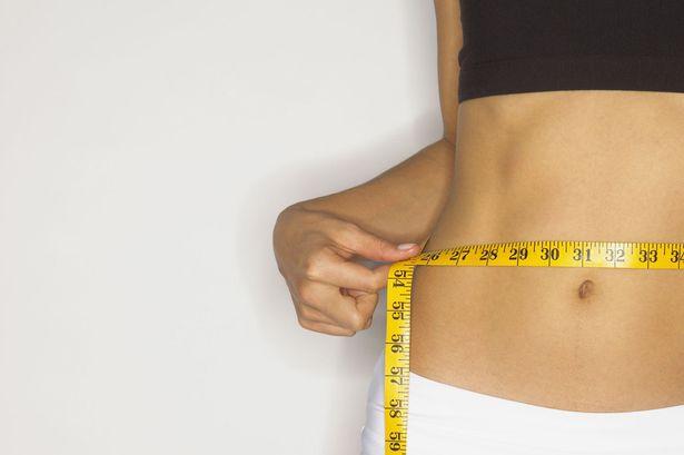 Woman+measuring+her+waist